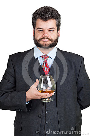 Businessman holding at a glass of whisky