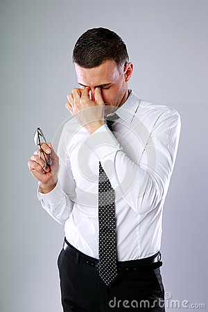 Businessman holding glasses Stock Photo