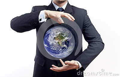 Businessman holding globe