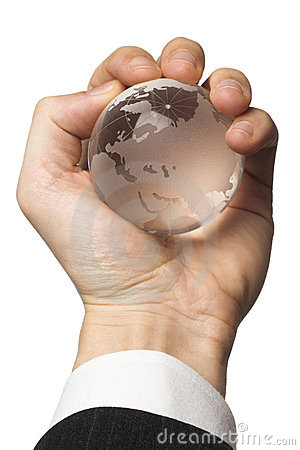 Businessman holding the globe