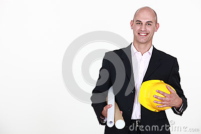 Businessman holding a helmet