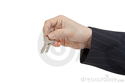 Businessman holding the Keys to success