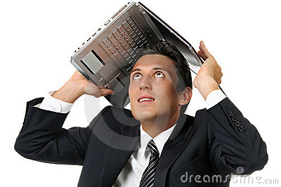 Businessman holding a laptop above his head