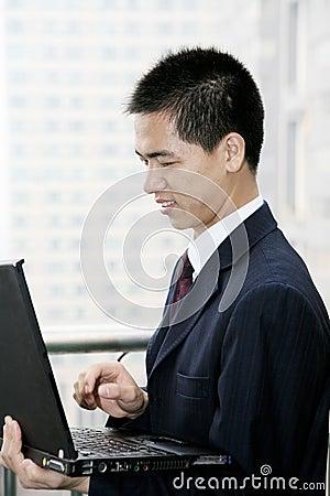 Businessman holding laptop computer