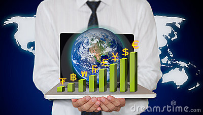 Businessman holding laptop with currency graph