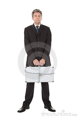 Businessman holding metal suitcase