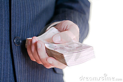 Businessman holding money stack