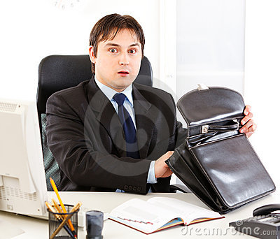 Businessman holding open suitcase in hands