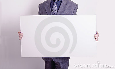 Businessman holding out a blank card