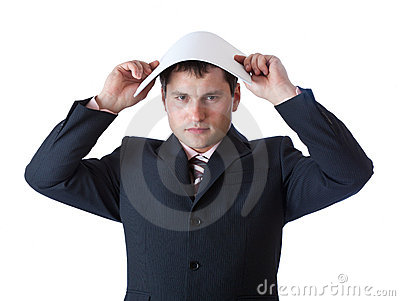 A businessman is holding a paper above his head