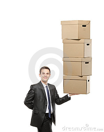 Businessman holding a paper boxes