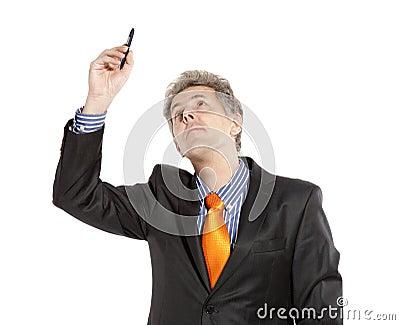 Businessman holding pencil