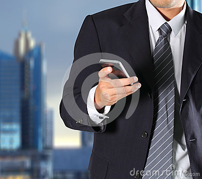 Businessman holding the phone