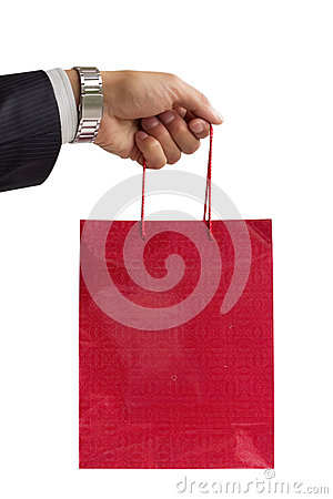 Businessman holding red gift bag