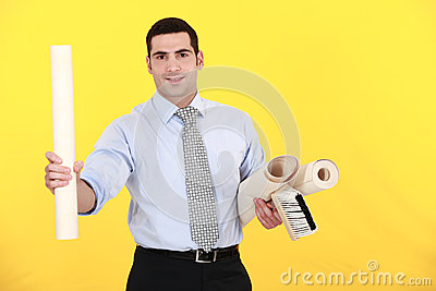 Businessman holding a roller