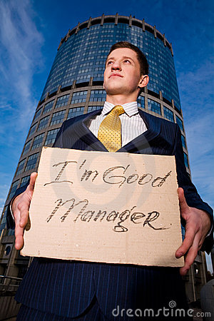 Businessman holding sign I am good Manager
