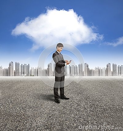 Businessman holding smart phone with cloud computi