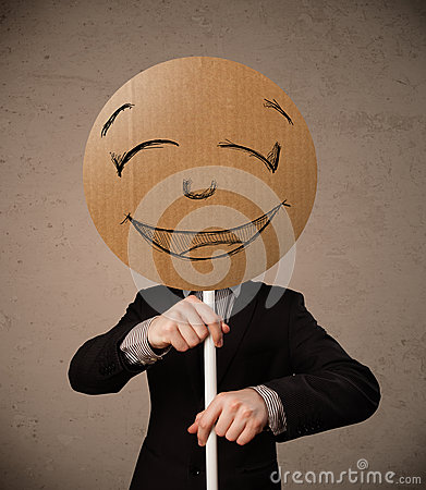 Businessman holding a smiley face board Stock Photo