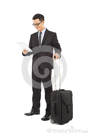 Businessman holding a tablet  with briefcase