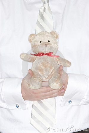 Businessman holding Teddy Bear