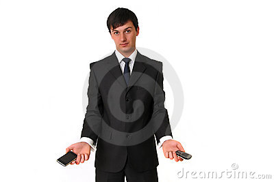 Businessman holding two mobile phones