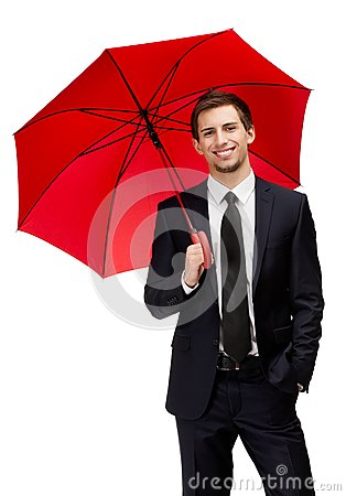 Businessman holding umbrella overhead