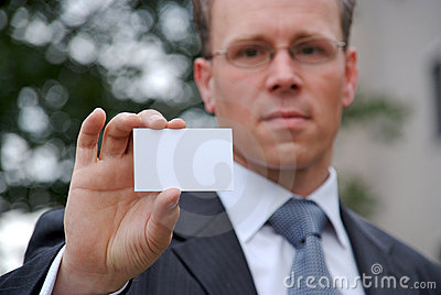 Businessman holding up businesscard