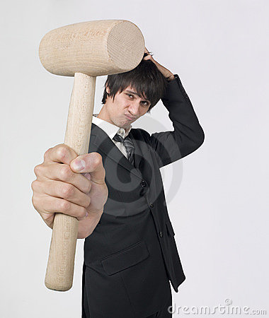Businessman holding wooden mallet