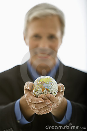 Businessman holding world.
