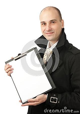 Businessman holds a blank paper sheet