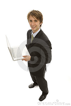 Businessman holds laptop