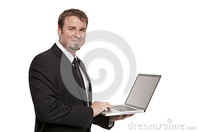 Businessman holds a Laptop