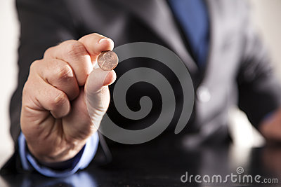 Businessman Holds Penny