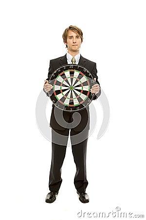 Businessman holds target