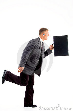 Businessman in hurry with briefcase