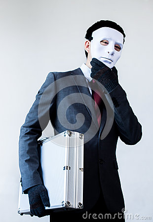 Free Businessman In Disguise Mask Stealing A Confidential Suitcase Royalty Free Stock Images - 81001169