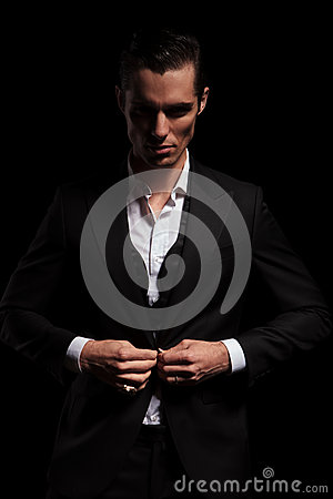 Free Businessman In Suit Posing In Studio Background Closing His Jack Stock Photo - 66334110