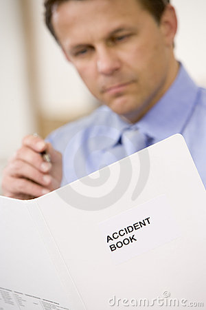 Free Businessman Indoors Looking At Accident Book Royalty Free Stock Images - 5709479