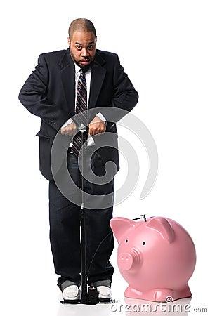 Businessman Inflating Piggy Bank