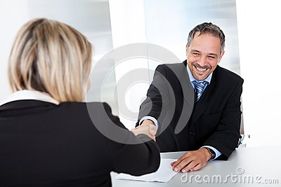 Businessman at the interview shaking hands