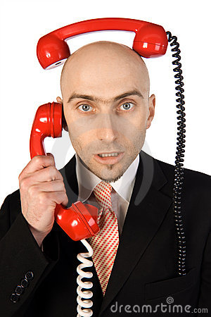 Businessman Juggling Two Calls