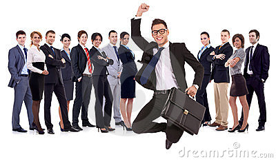 Businessman jumping in front of his team