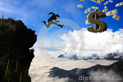 Businessman jumping from mountain