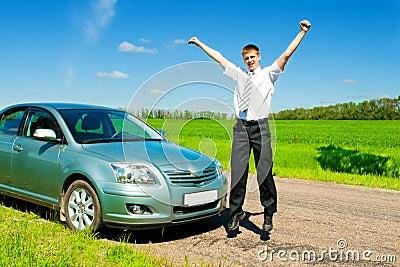 Businessman jumping near car