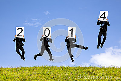 Businessman jumping with 2014 year