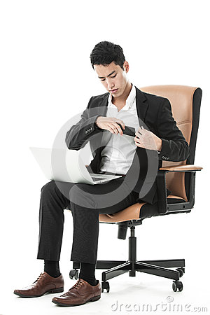 Businessman keep his phone in his suit