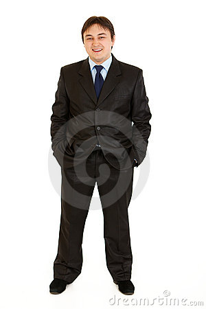 Businessman keeping his hands in trousers pockets