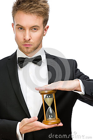 Businessman keeping hourglass