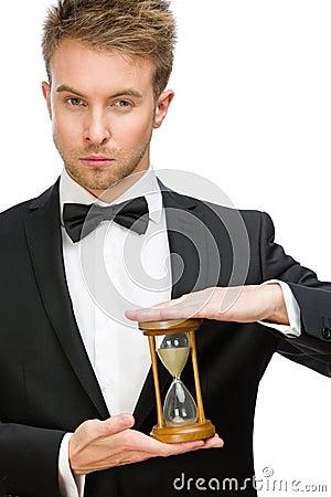 Businessman keeping hourglass