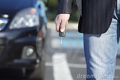 Businessman with key and car